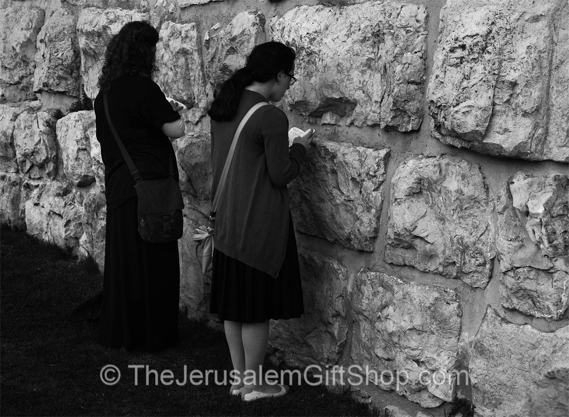 Girls Praying by Old City Walls - Photo by Ian Norton
