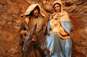 A serene statue at the entrance to the Milk Grotto captures the scene of the Holy Family setting out on their flight to Egypt.