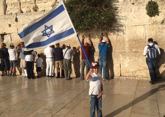 Child celebrating Israel at the Kotel - Western Wall