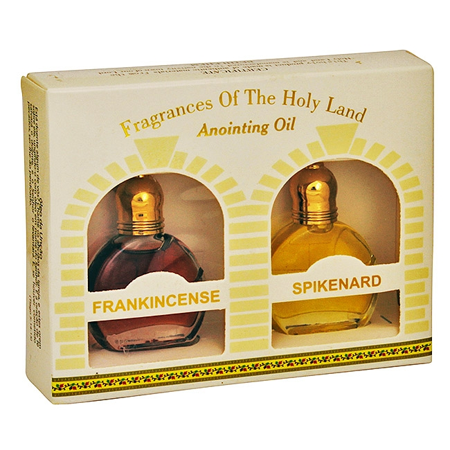 Two bottle gift pack containing Frankincense and Spikenard anointing oil sitting behind two Jerusalem style windows . Anointing oil created from oil from the Galilee region. Is anyone among you sick? Let him call for the elders of the church, and let them #gift