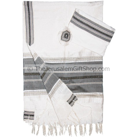 Beautifully made Gabrieli Silk Tallit set with Grey stripes and gold thread woven onto white silk Set includes three matching pieces:Talit.Kippa.Matching Bag. Size: 20 x 80 inch made from pure silk of the highest quality Note: These unique Tallit sets are #silk