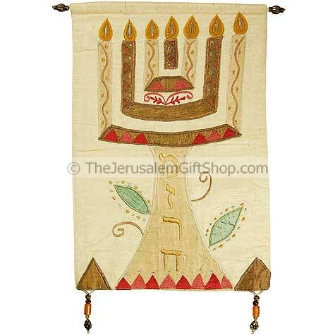Beautifully embroidered with silk this Menorah with 'Mizrach' written in Hebrew on an off-white background would look stunning on the wall of your home or church. Size: 12.5 x 18 inches.Mounting pole made from Brass. Written on the menorah stem in Hebrew #silk