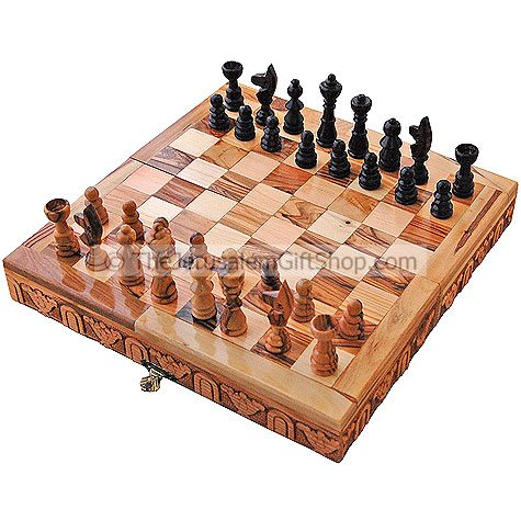 Olive Wood Chess board with real olive wood pieces - also a great conversation piece! Hand made in Bethlehem. Board size open: 9.5 x 9.5 x 1.7 inches. Pieces store inside board for easy storage. Unique gift from the Holy Land. Shipped direct from the Holy #gift