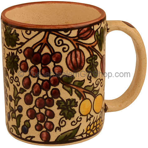 Hand painted Armenian ceramic beige 'Seven Species' mug. Made in Jerusalem.Size: 4 inches / 10cm high. Lead free. Dishwasher safe. A land of wheat, and barley, and vines, and fig trees, and pomegranates; a land of olive oil , and honey (Deuteronomy 8:8) S #mug